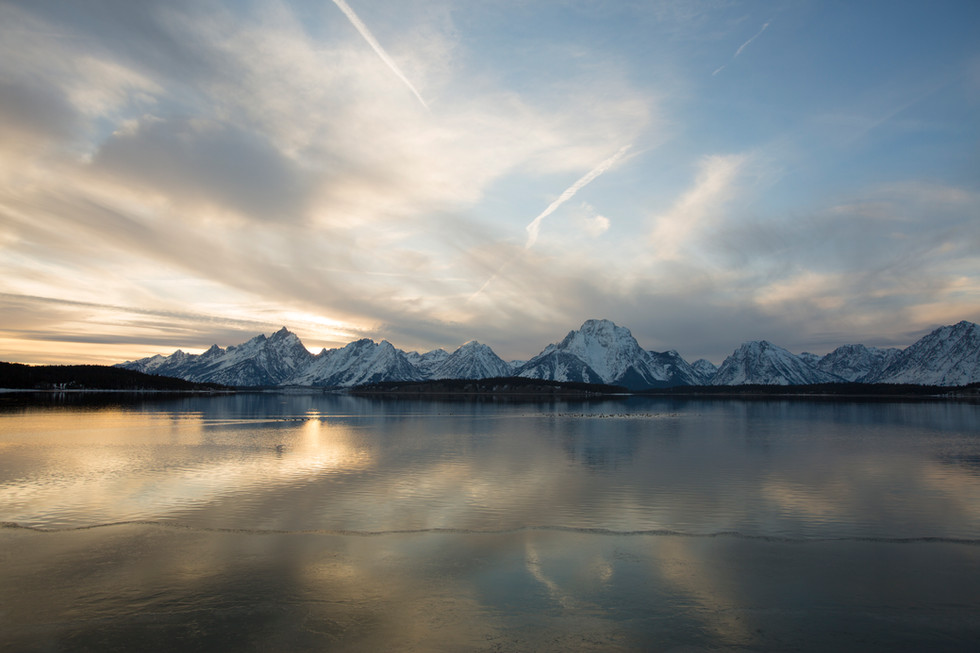 The sun sets onJackson Lake in Grand Teton National Park.