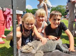 Fayre with children and Madam Mim