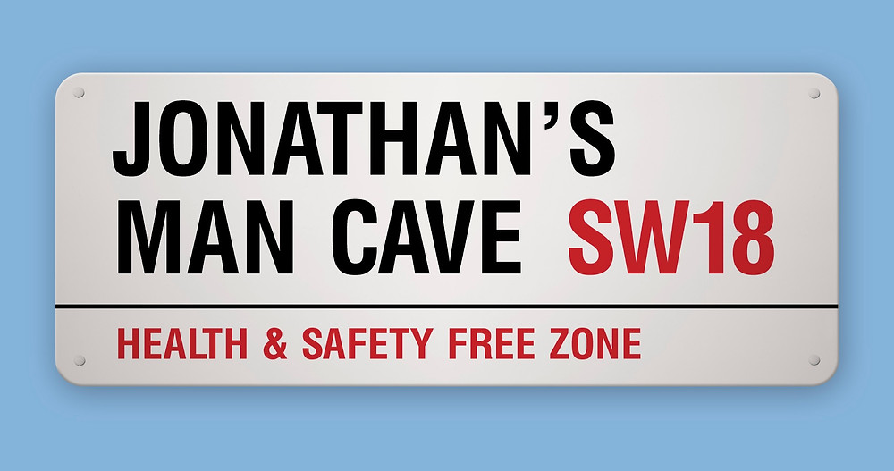 A London Street Sign personalised with Jonathan's man cave SW18 health and safety free zone