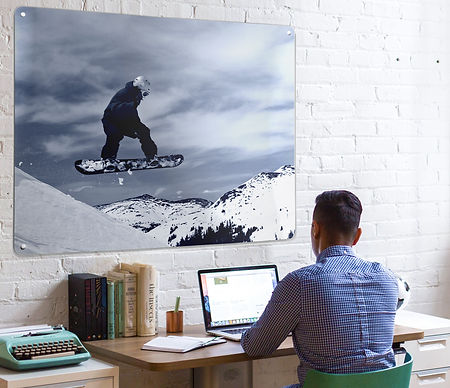 man in office with personalised magnetic notice board wall art panel of snowboarder