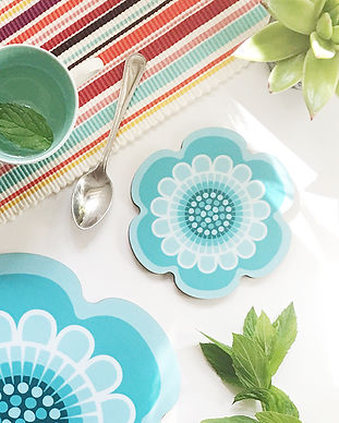 Flower Power retro design flower shaped placemat and coaster in a bright aqua colour