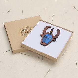 bull Bull design walnut pendant in a gif