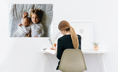 girl at a desk with create your own magnetic board of her children