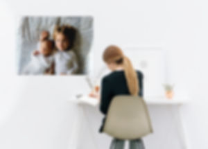 woman at desk with bespoke magnetic board with photograph of her children