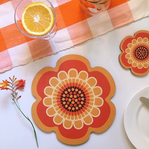 A pretty orange flower shaped placemat and coaster place setting