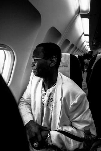 Ernest looks out the window as we fly out of Dakar, en route to Freetown, Sierra Leone, the home Ernest left more than 15 years ago