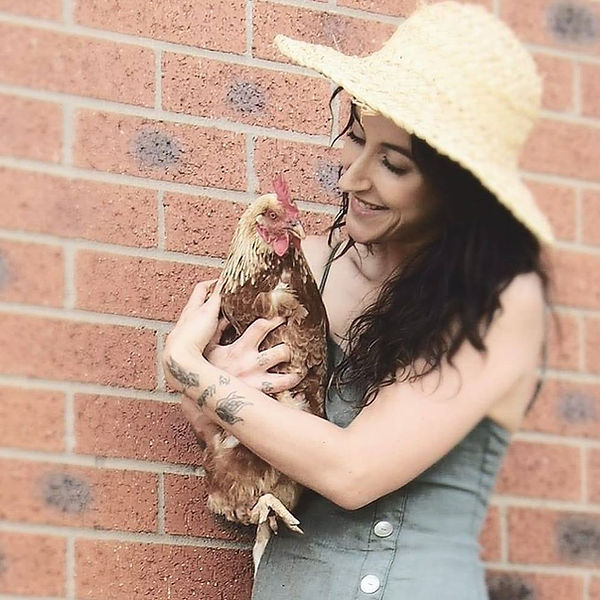 Blair Kalivati - Female Australian Holistic Coach With Her Free Range Chicken