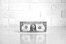 One dollar bill by the wall_edited.jpg