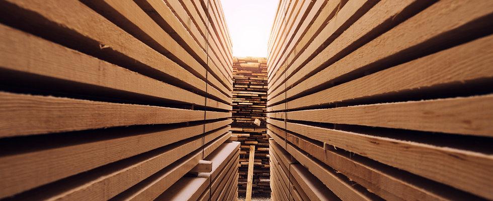 stack-wooden-planks-sawmill-lumber-yard.