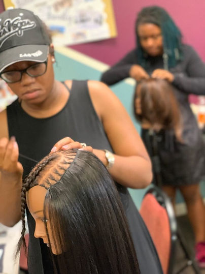 Natural Hair Students learning the sew-in extension technique