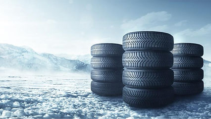 winter_tires_stacked_up_in_snow-mi.2e16d