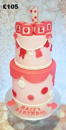 Pink and white girls first birthday cake