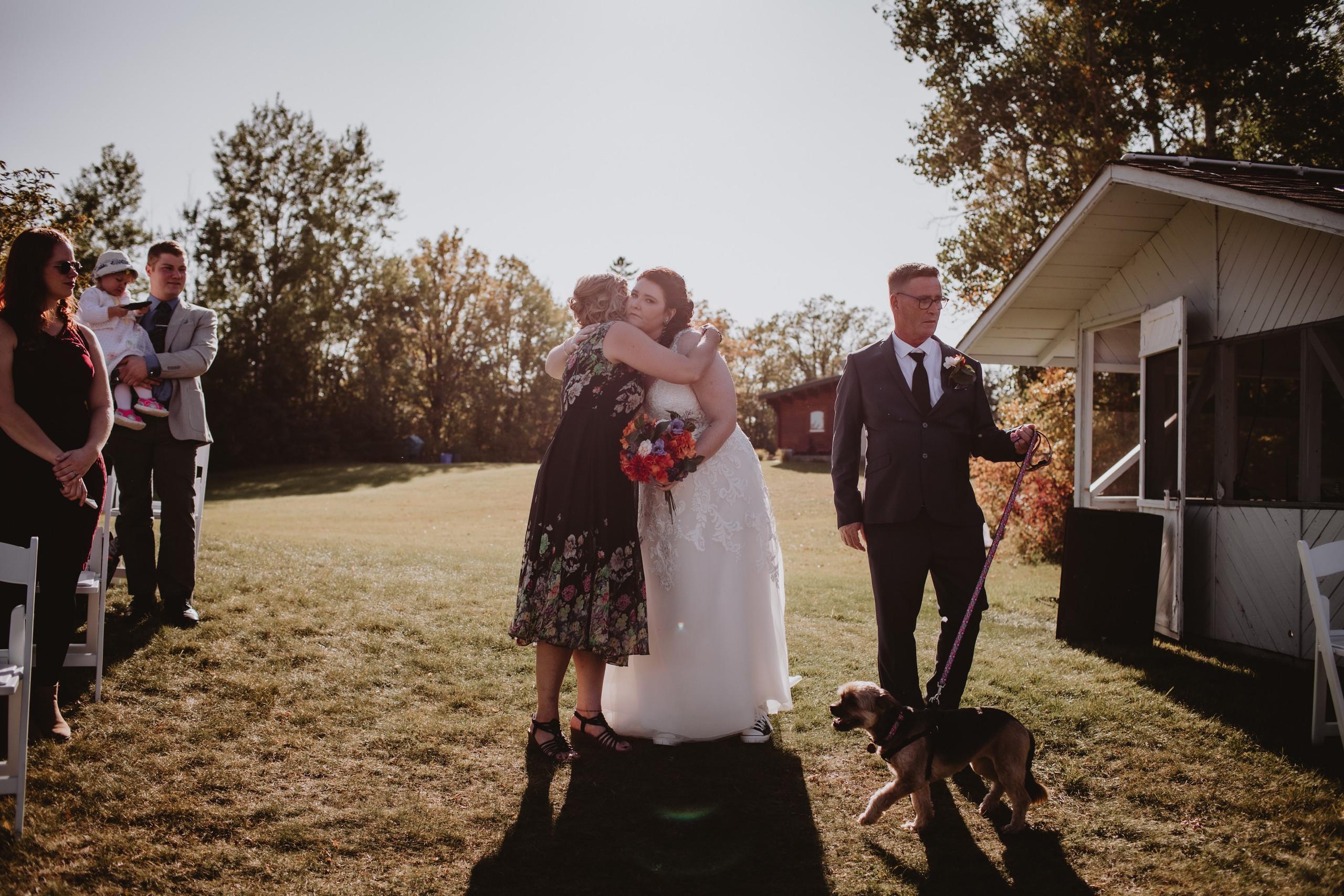 Bride Hugs Parents