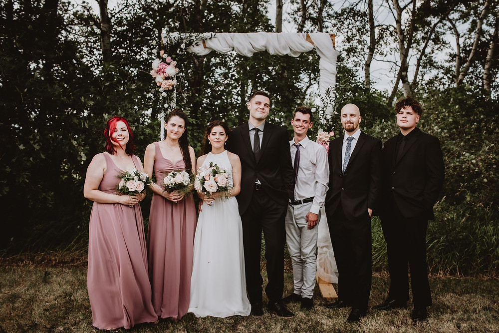 Bridal party portrait in front of altar.
