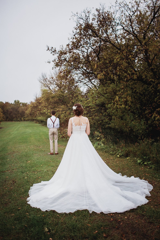 First look between groom, Scoot and bride, Kaitlyn for their fall wedding in Winkler, Manitoba