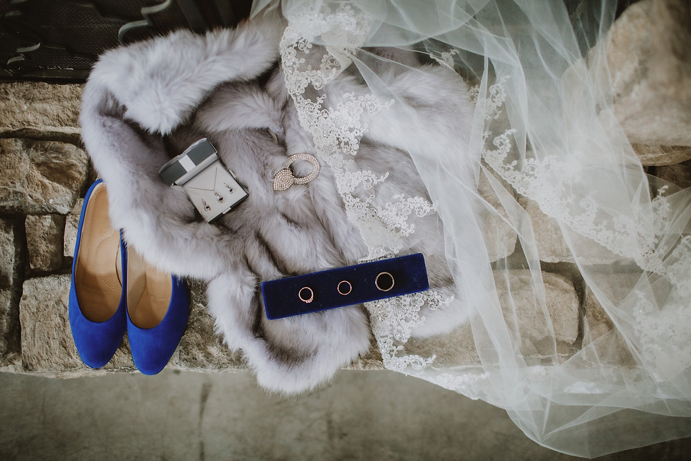 Velvet royal blue wedding shoes, faux-fur stole and handmade cathedral veil.