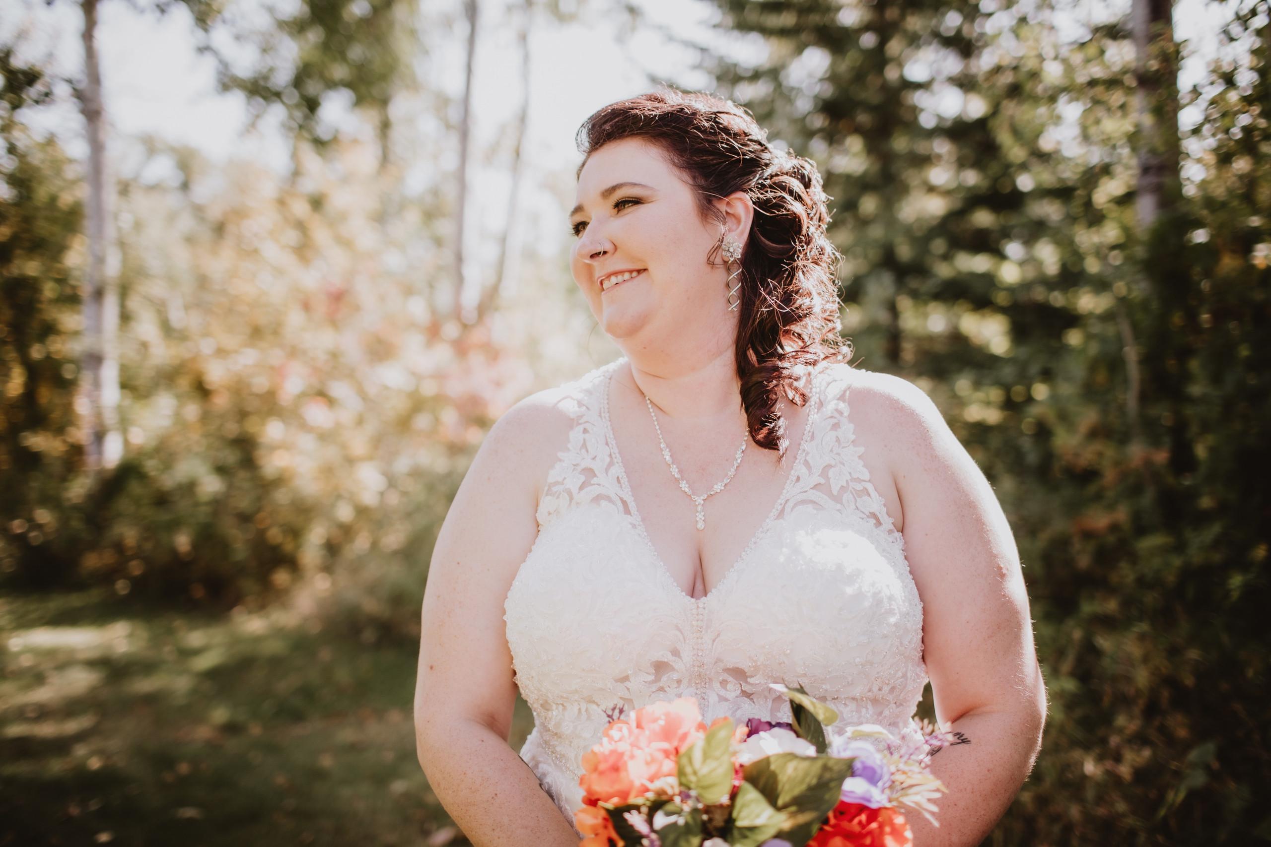 Smiling Manitoba Bride during fall wedding.