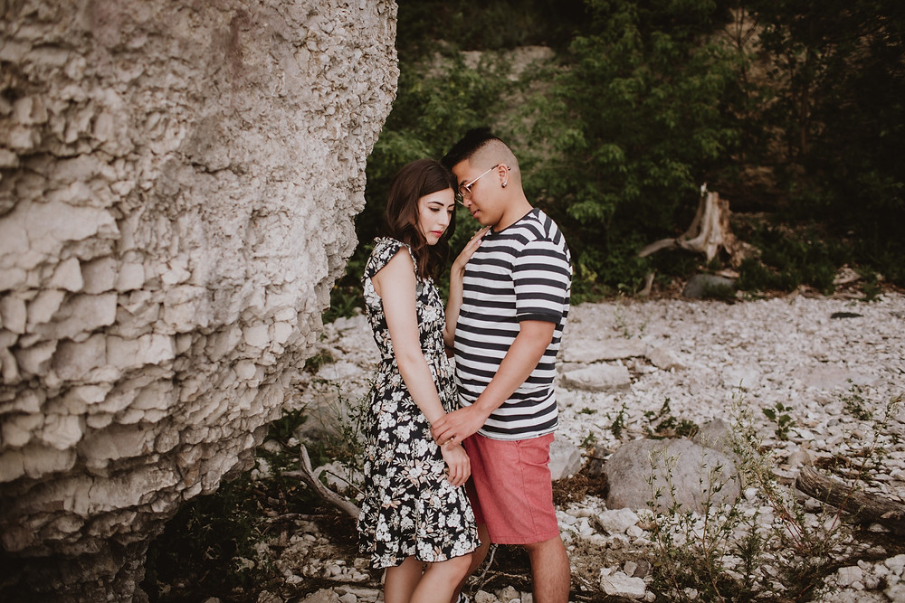 Floral, knee-length dress, paired with striped t-shirt and salmon shorts - engagement photo session outfits.