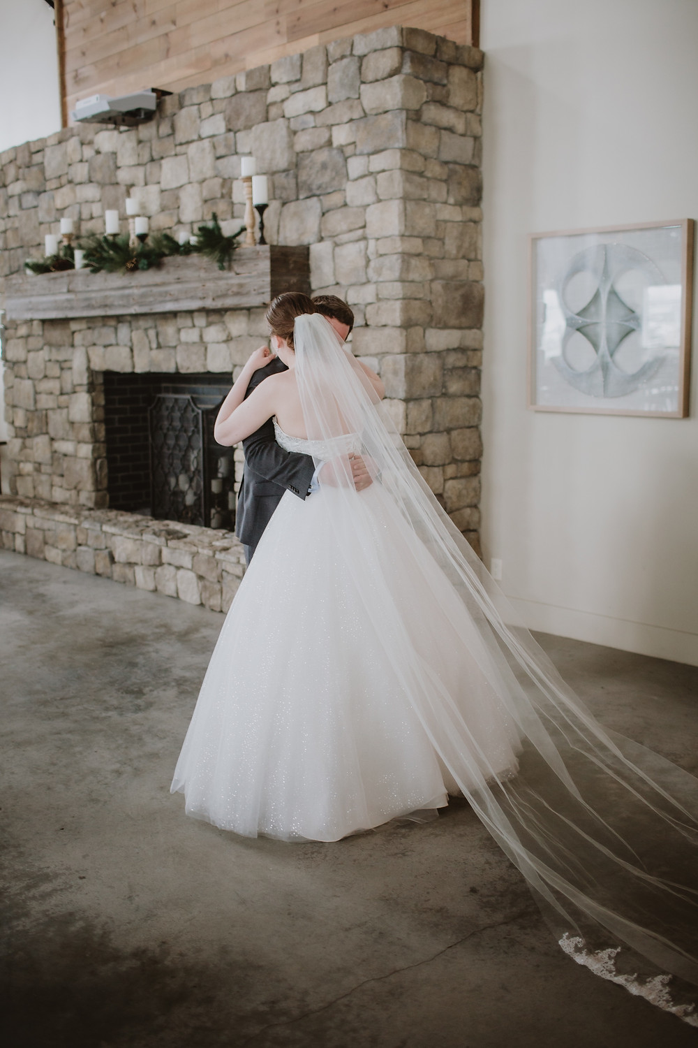 Wedding couple embraces after first look.