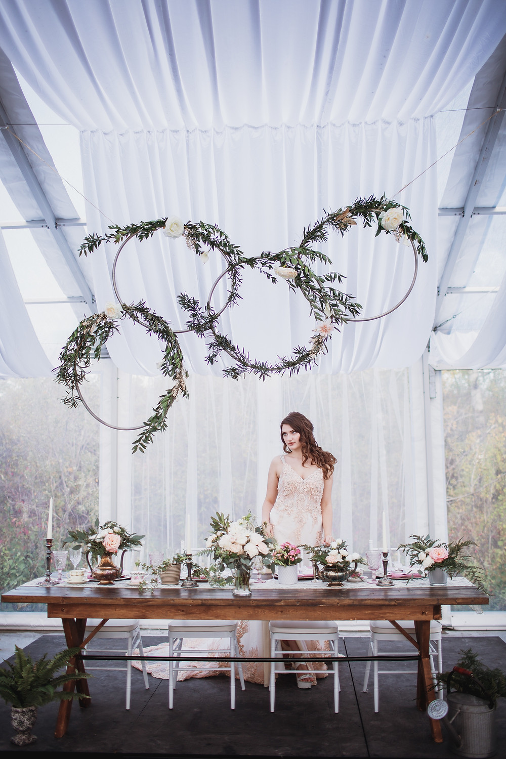Bride showcases wedding decor and bridal gown.