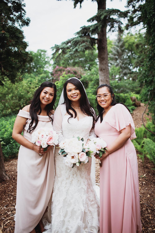 Bride-squad, bride poses with bridesmaids in Assiniboine park.