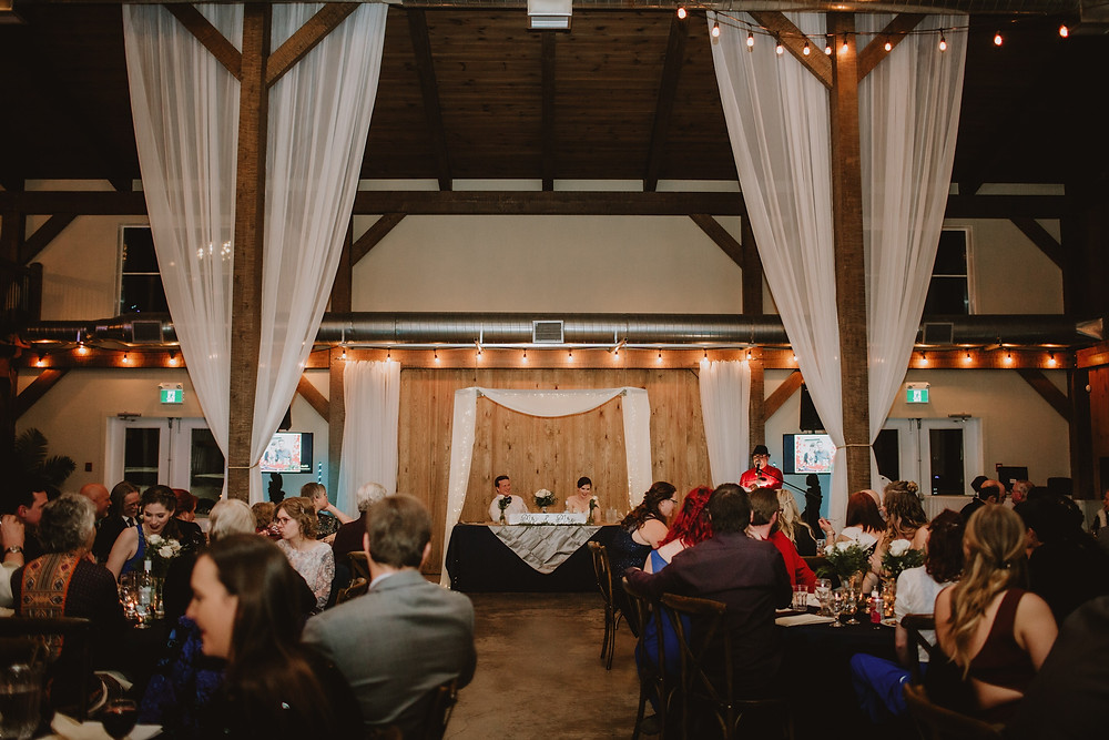 Indoor wedding reception with sweetheart table.