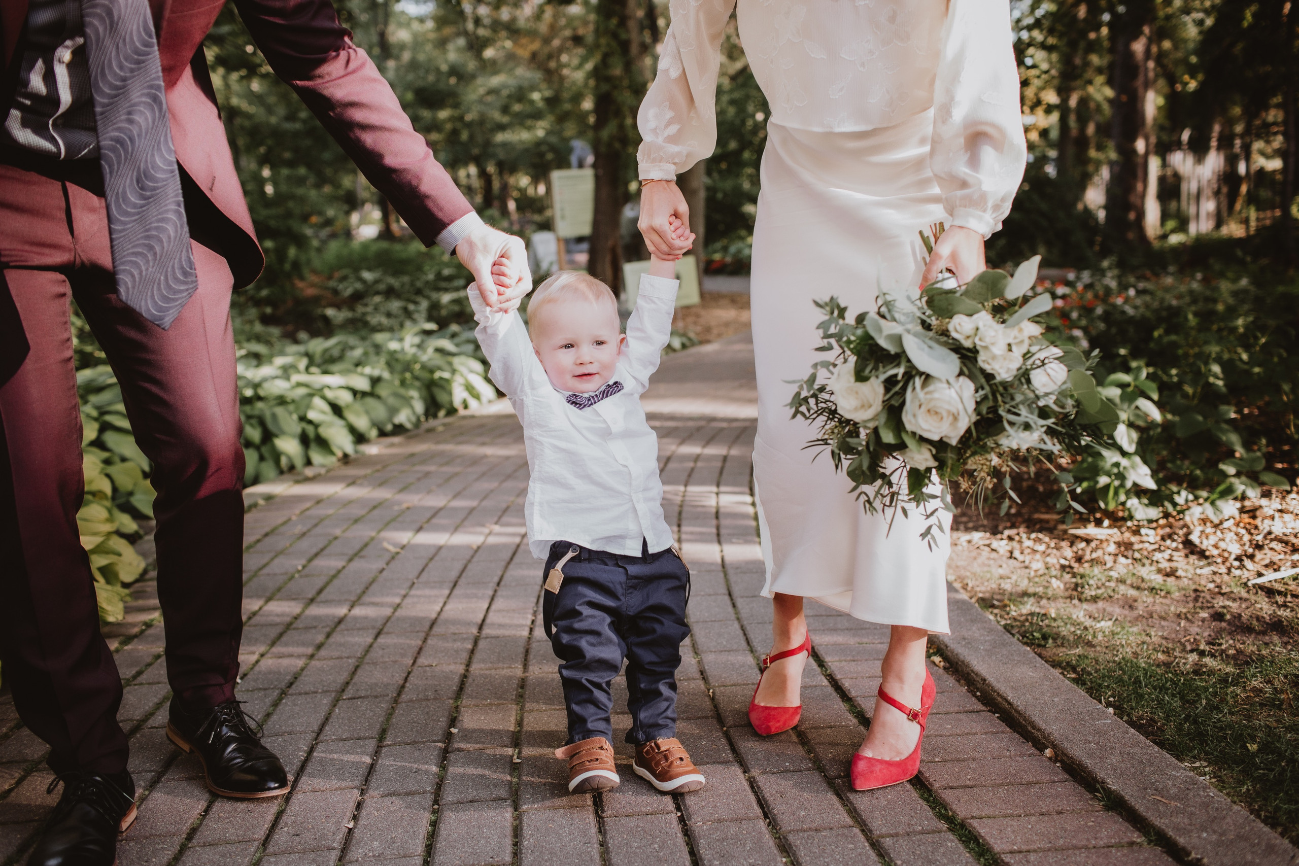 Bride and Groom with Son, during micro wedding in Winnipeg, Manitoba.