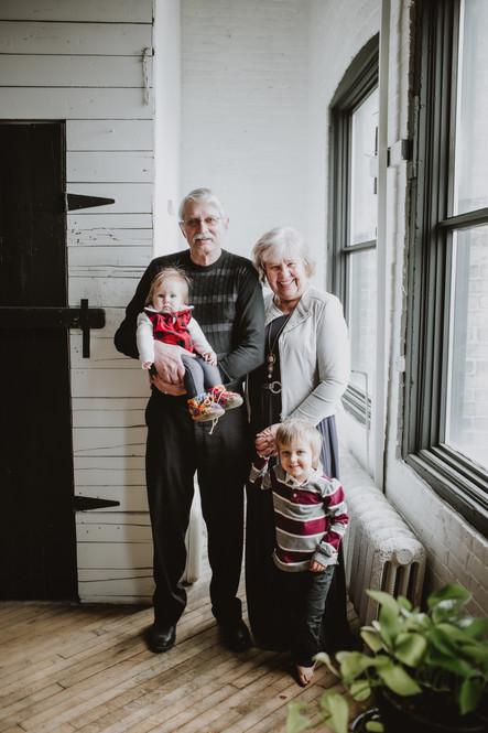 Grandparents Pose with their Grandbabies