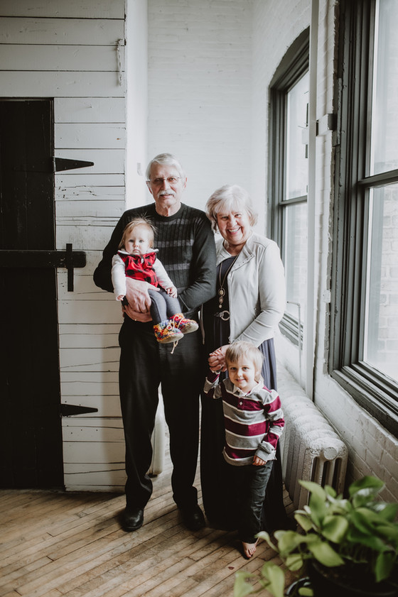 Grandparents Pose with their Grandbabies
