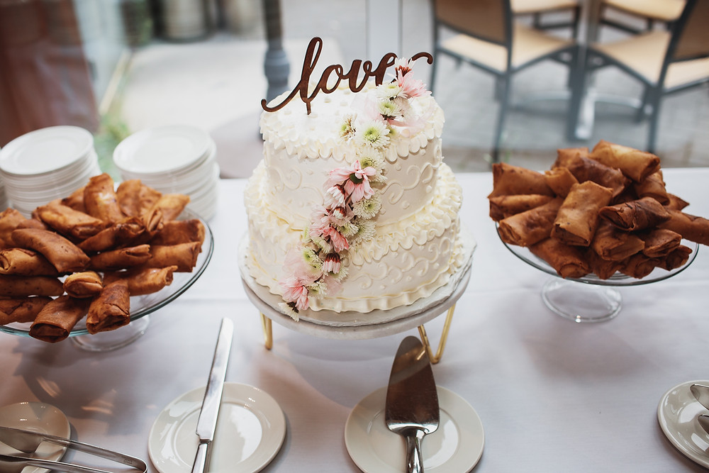 Wedding cake with wooden letter cake topper.