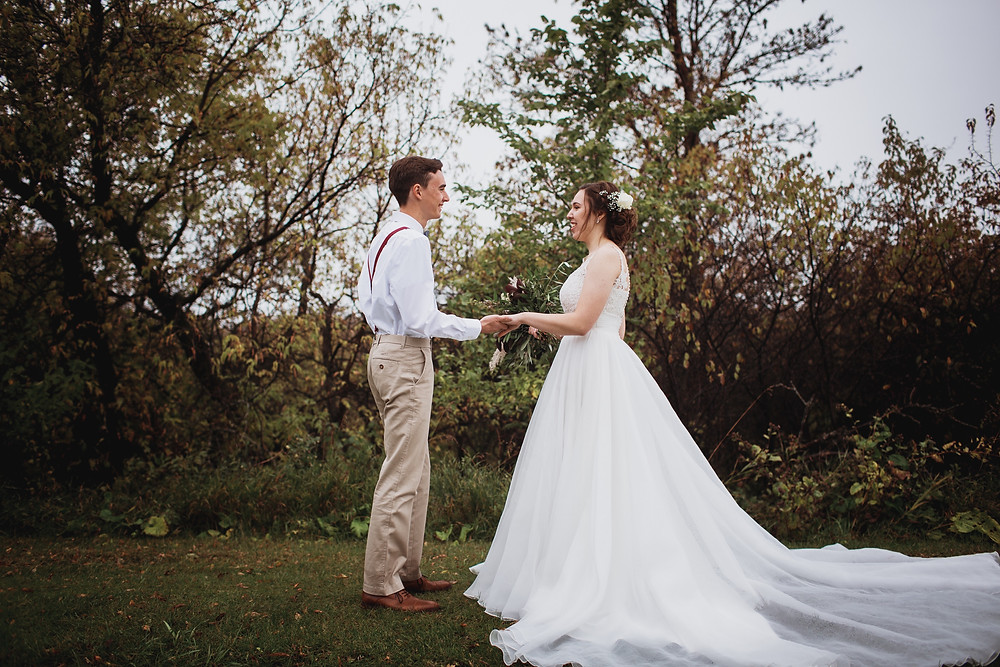 Bride and groom meet for the first time on their fall wedding day in Winkler, Manitoba.