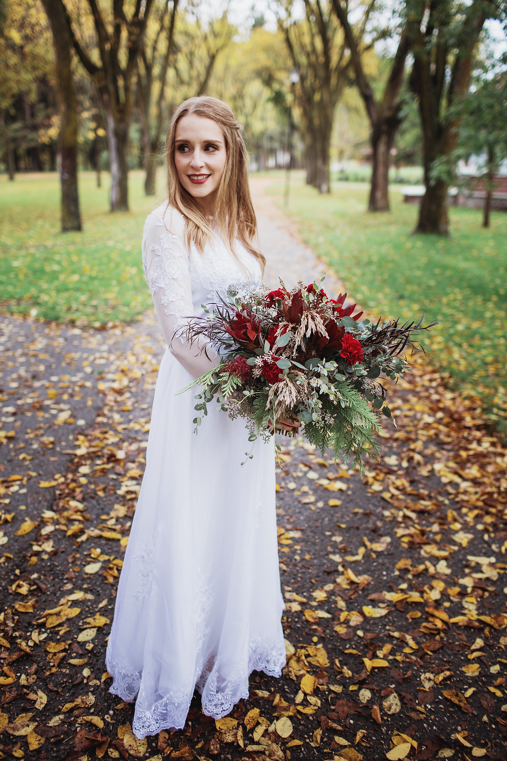 Fall bridal inspiration.Bride wears her mother's dress, holding a hearty fall bouquet.