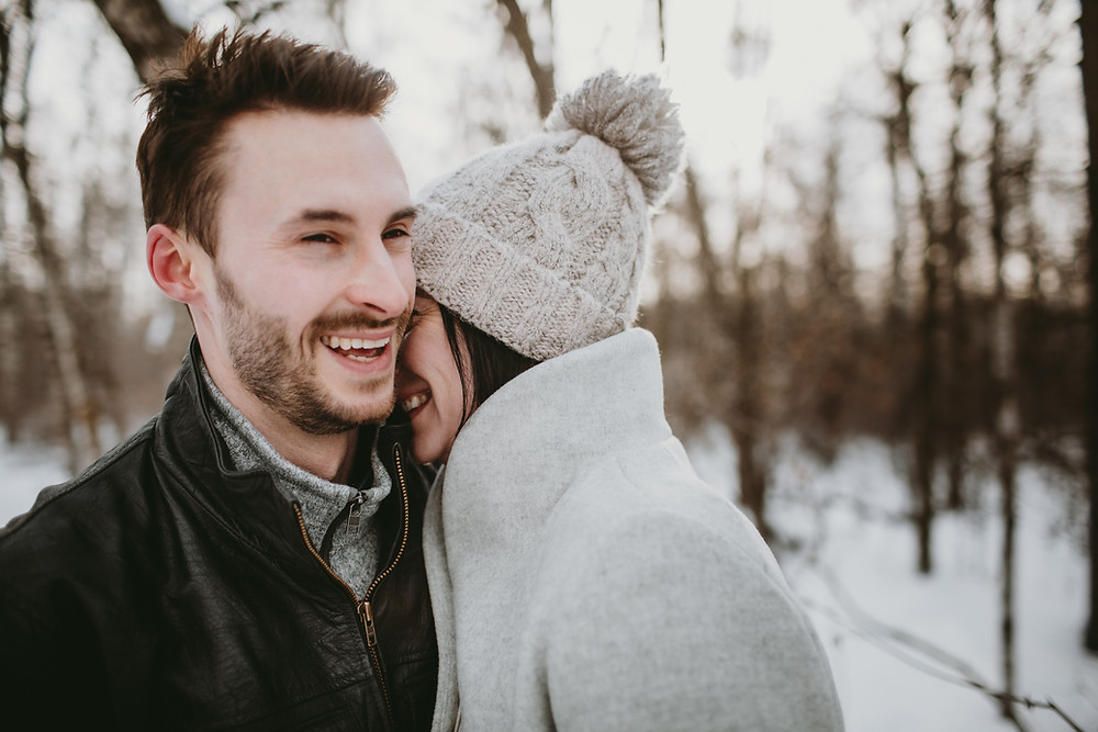 Couple laughing during winter engagement session