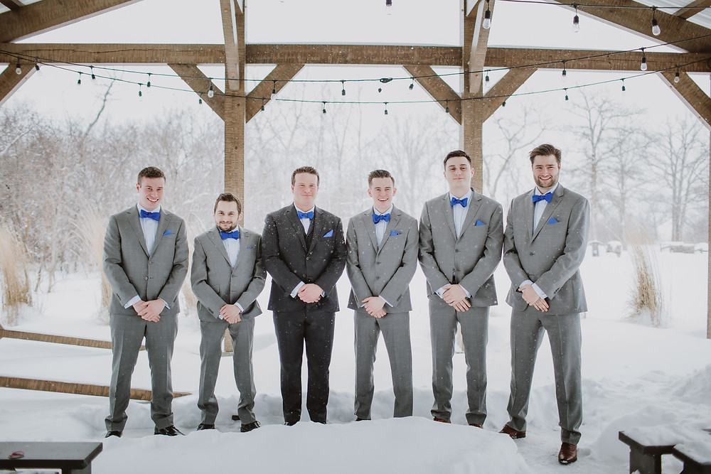 Groomsman in grey suits with royal blue bow ties. Suits from Moore's.