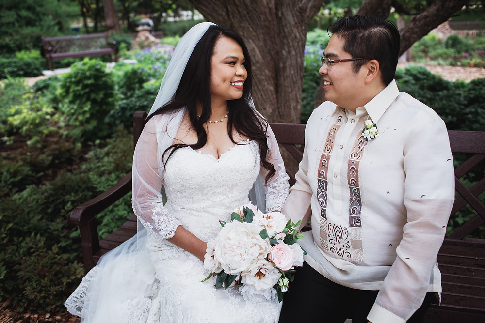 Winnipeg wedding photography, Filipino bride and groom share a moment in the English Gardens in Assiniboine Park.