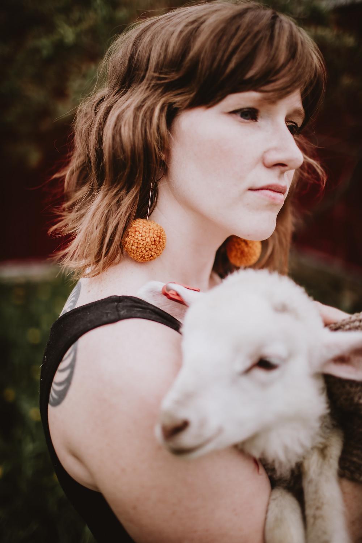 Pumpkin coloured pom earrings.