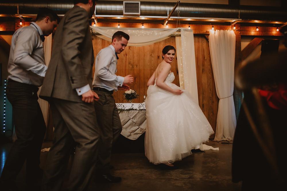 Bride and groom line dance with groomsmen