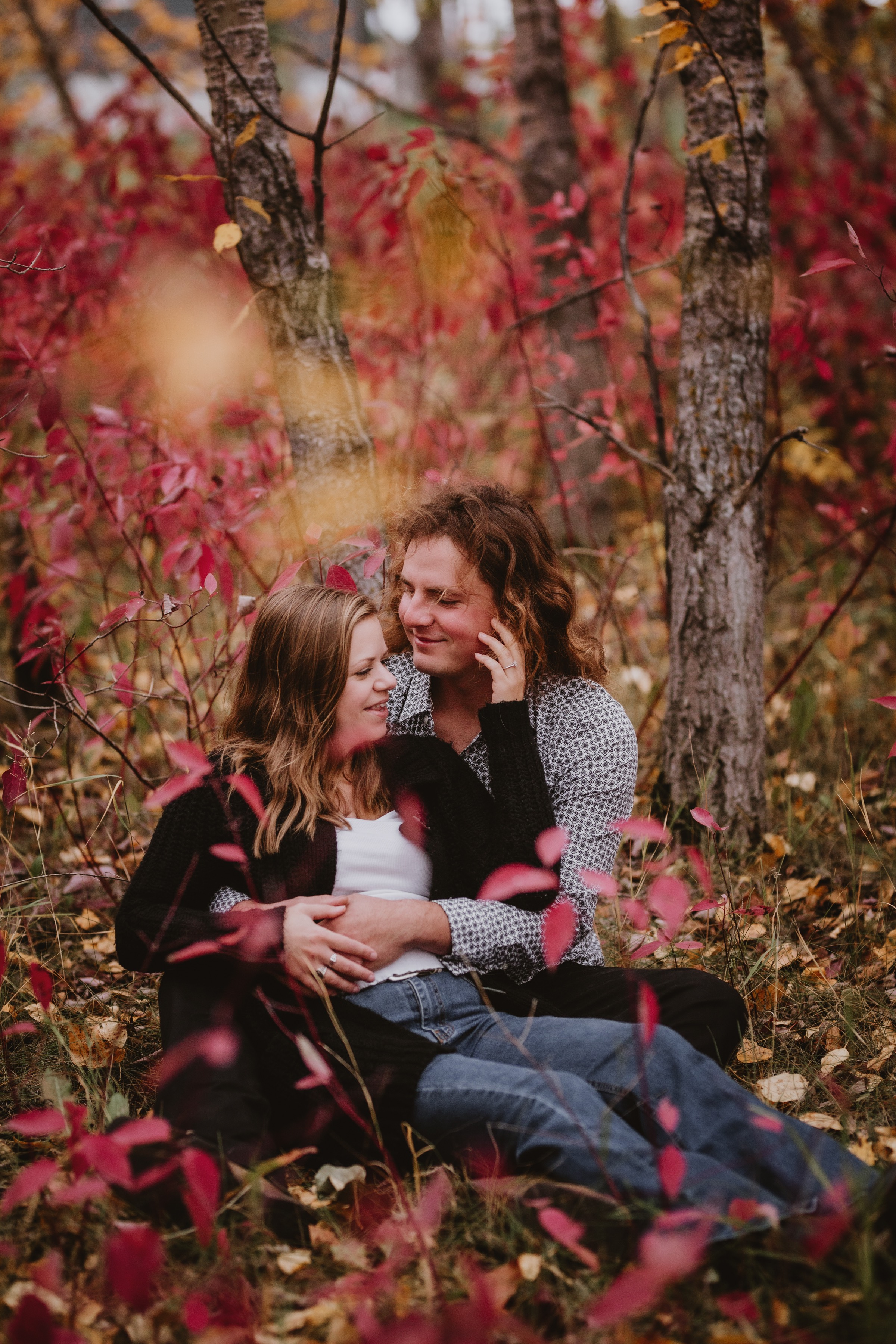 Couple Cuddles in Forest during beautiful fall photo session