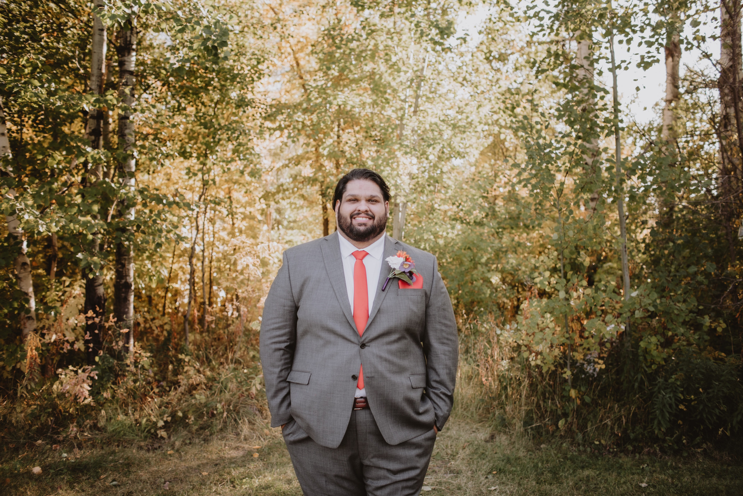 Groom Poses for Portrait during fall wedding day in Manitoba.