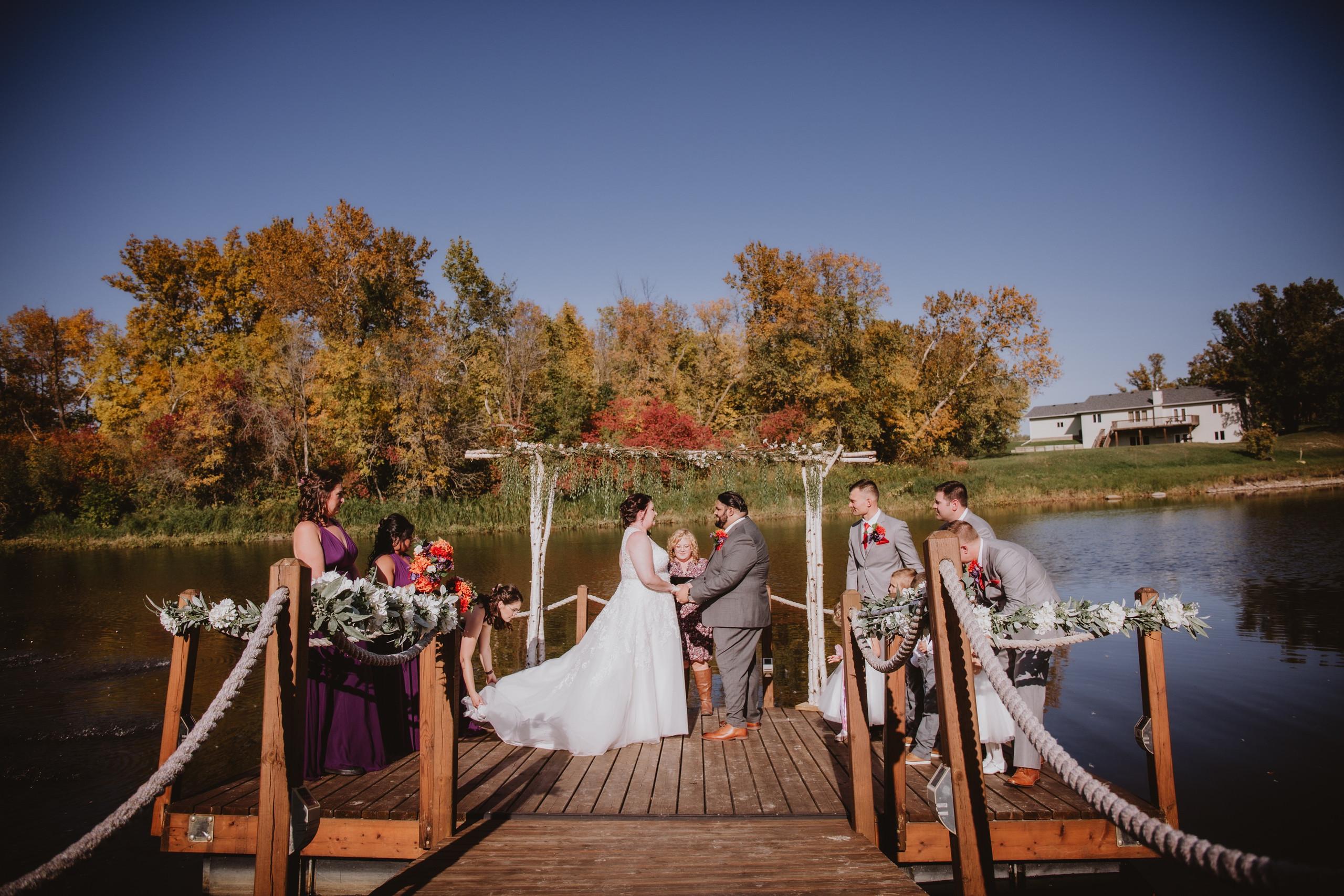 Fall Wedding Ceremony overlooking water.