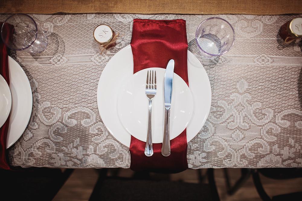 Burgundy wedding linens for fall wedding.