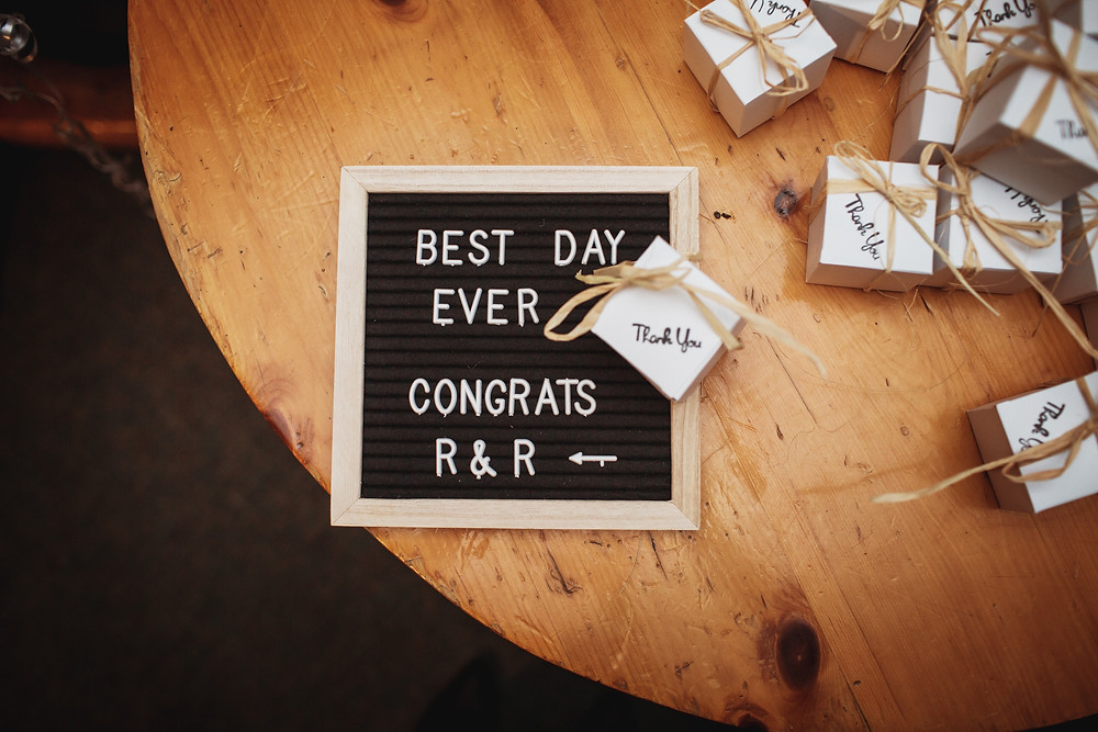"Wedding favours with sign that reads ""Best Day Ever. Congrats R&R"""