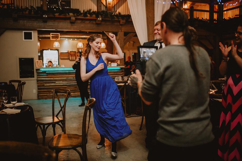 Bridesmaid enters wedding reception dancing.