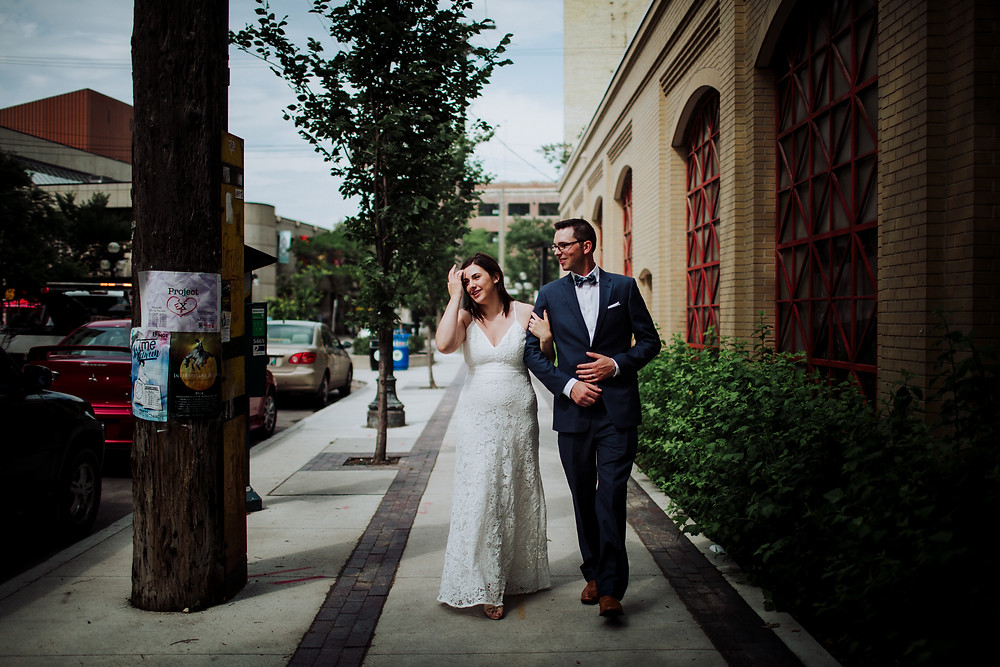 Newlyweds walk through the exchange district in Winnipeg, MB.