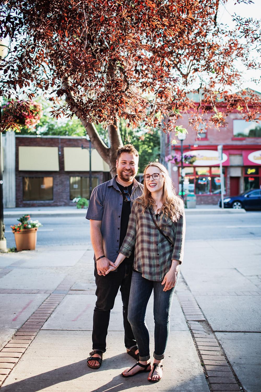 Couple poses along Osborne Street in Winnipeg, MB.