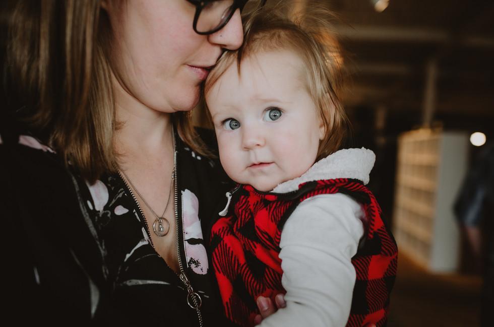 Mama Kisses Baby Girls Forehead