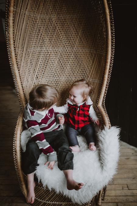Siblings Pose on Giant Wicker Chair
