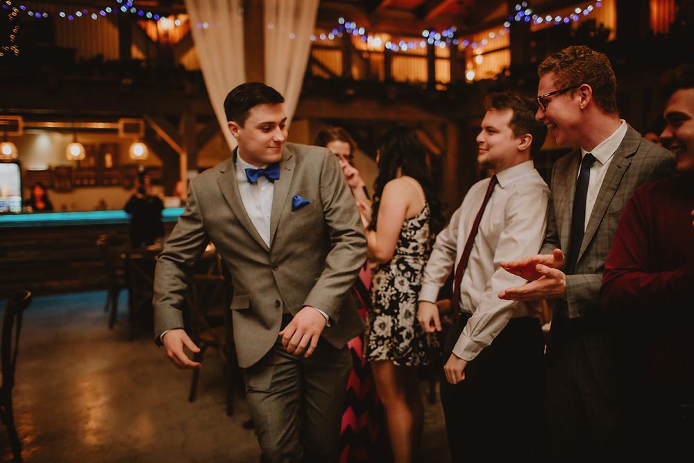 Groomsman enters Manitoba wedding reception.