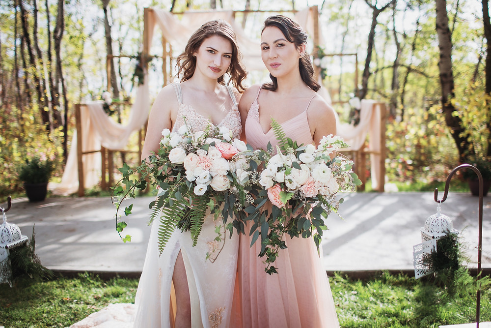 Blush wedding gown by Anna Lang Bridal, light pink bridesmaid gown from Pearl and Birch.