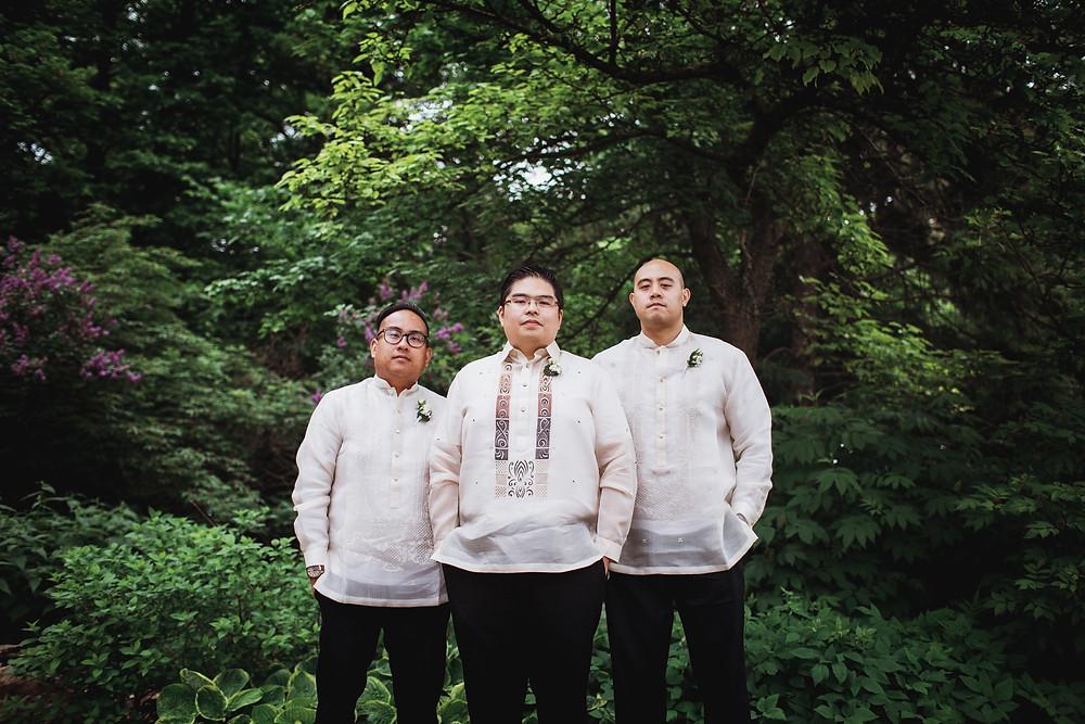 Groomsmen pose for wedding day portraits in Assiniboine Park.